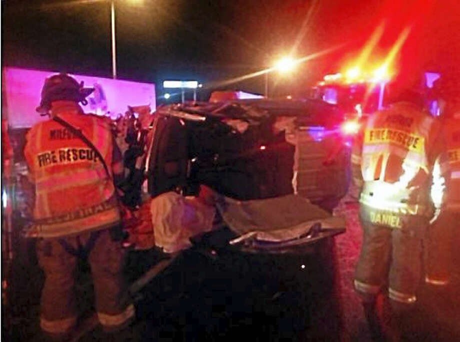 Milford fire crews extricated a man from his SUV after he drove the wrong way on Interstate 95 and hit an oncoming vehicle then rolled across the traffic lanes early Monday. Photo: (Photo Courtesy Of Christopher Zak/Milford Fire Department)