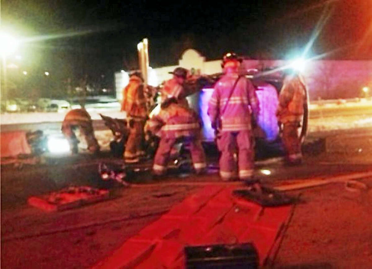 Milford fire crews extricated a man from his SUV after he drove the wrong way on Interstate 95 and hit an oncoming vehicle then rolled across the traffic lanes early Monday.