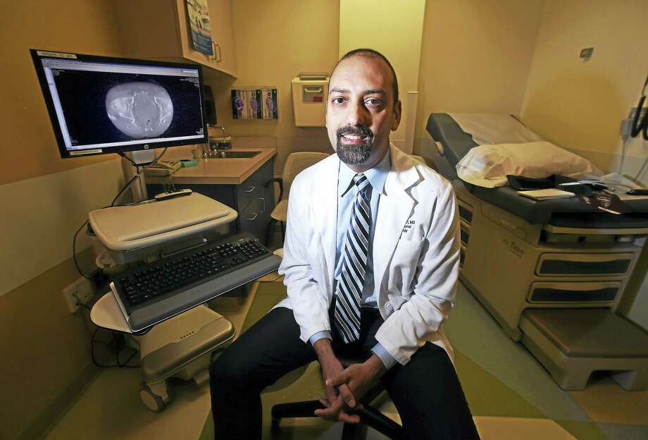 Dr. Raj Ayyagari, an interventional radiologist, photographed at Yale Physicians Building on May 30 uses a relatively new procedure, prostate artery embolization, to treat enlarged prostates. Photo: Arnold Gold — New Haven Register