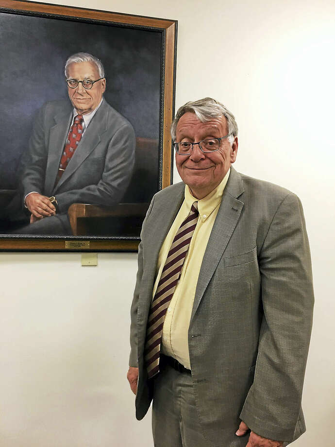 New Haven Probate Judge Jack Keyes poses in front of a portrait of his father, Thomas F. Keyes Jr., who preceeded him in that office. Photo: Mary O'Leary — New Haven Register