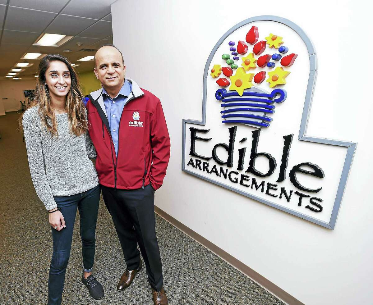 Somia Farid, left, special projects manager for Edible Arrangements, is photographed with her father, Tariq Farid, founder and CEO, at the company headquarters in Wallingford.