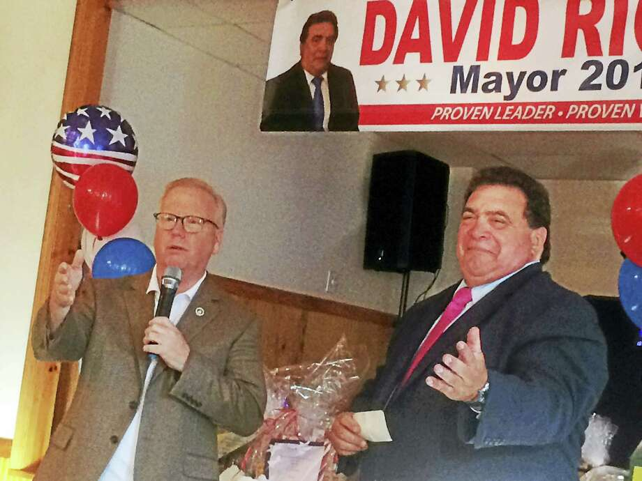 West Haven Republican mayoral candidate David Riccio, right, beams as longtime Danbury mayor and Republican gubernatorial candidate Mark Boughton praises him at Riccio's formal campaign announcement Saturday evening at the West Haven Police American Political Club on West Spring Street. Photo: Mark Zaretsky - New Haven Register