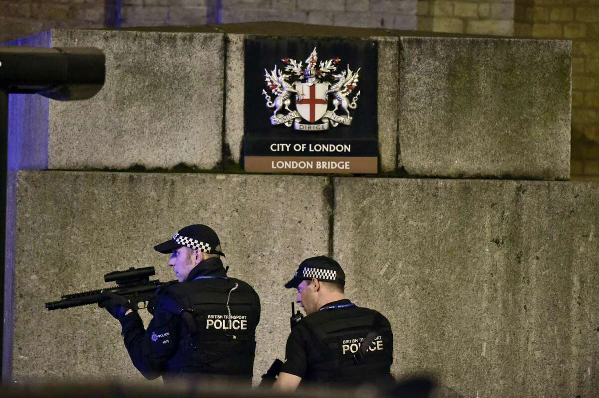 """An armed Police officer looks through his weapon on London Bridge in London, Saturday, June 3, 2017. British police said they were dealing with """"incidents"""" on London Bridge and nearby Borough Market in the heart of the British capital Saturday, as witnesses reported a vehicle veering off the road and hitting several pedestrians."""