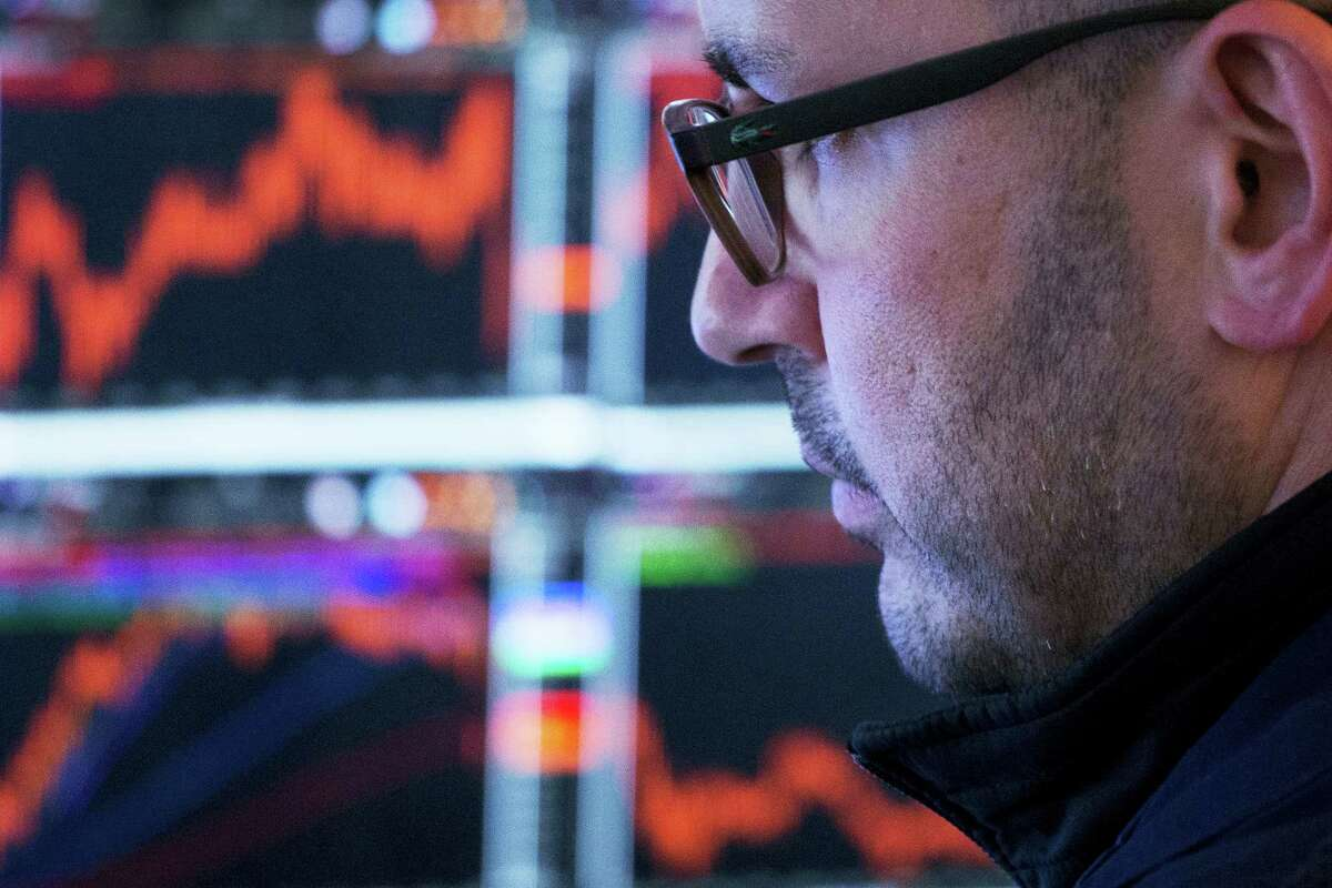 A trader works at the New York Stock Exchange Monday.