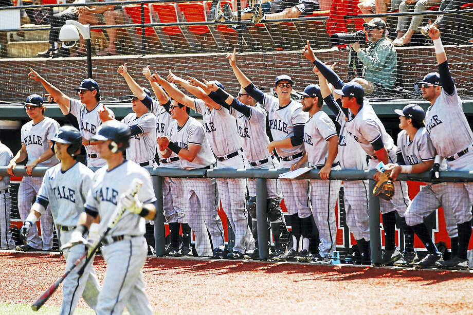 Members of the Yale baseball team celebrate a run during the Bulldogs win over Nebraska in the first game of the NCAA regional in Corvallis, Oregon. Photo: Yale Sports Publicity   / ©2017 Steve Dipaola