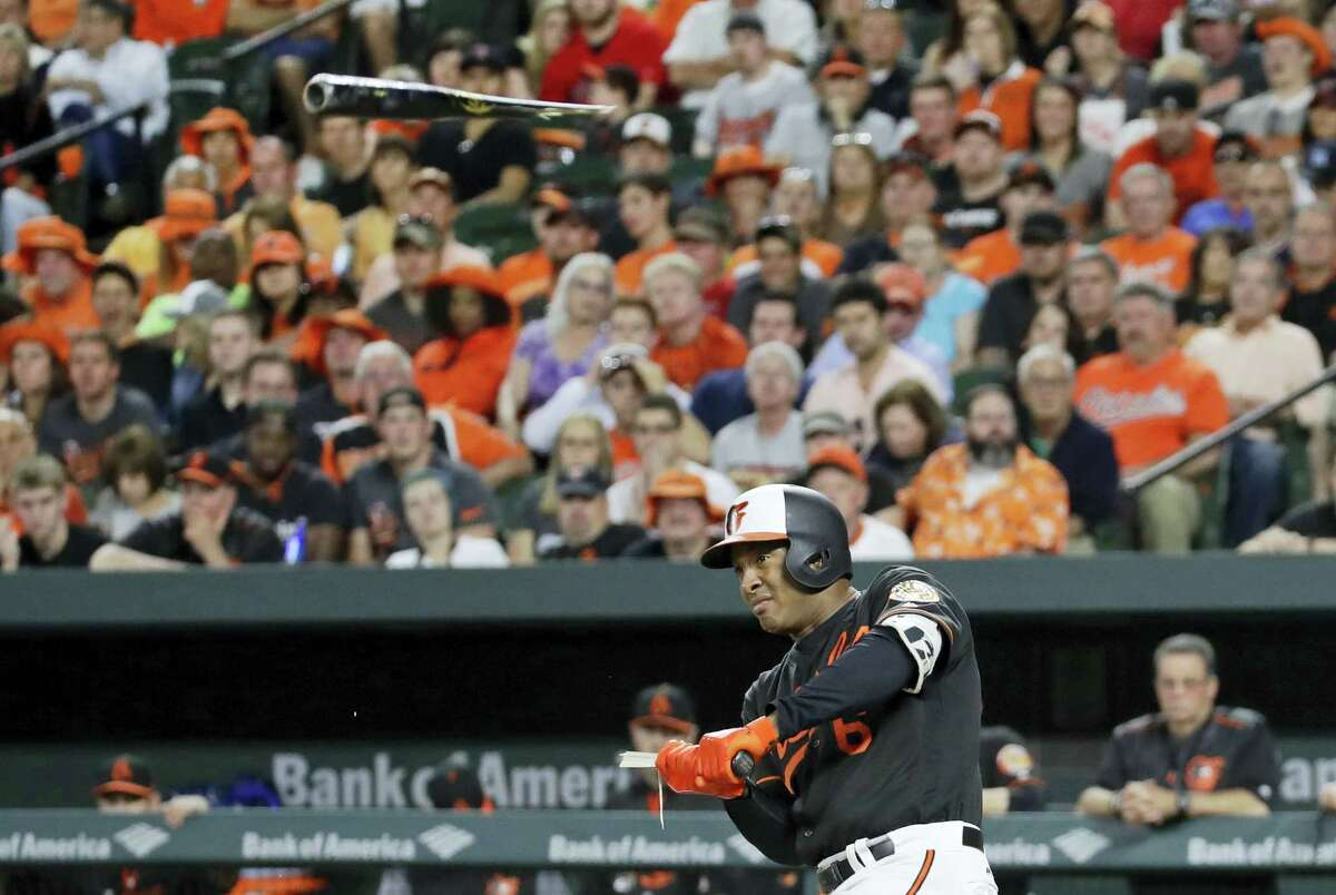 Baltimore Orioles' Jonathan Schoop breaks his bat as he singles in the sixth inning of a baseball game against the Boston Red Sox in Baltimore, Friday, June 2, 2017. (AP Photo/Patrick Semansky)