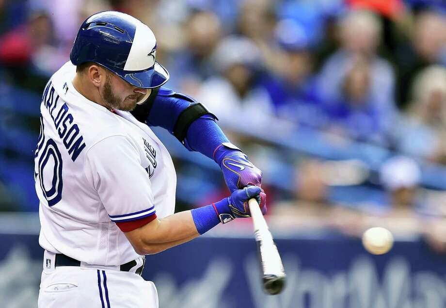 Toronto's Josh Donaldson hits a solo home run against the New York Yankees during the first inning Friday. Donaldson hit two homers as the Blue Jays beat the Yankees 7-5. Photo: Frank Gunn/The Canadian Press Via AP   / The Canadian Press