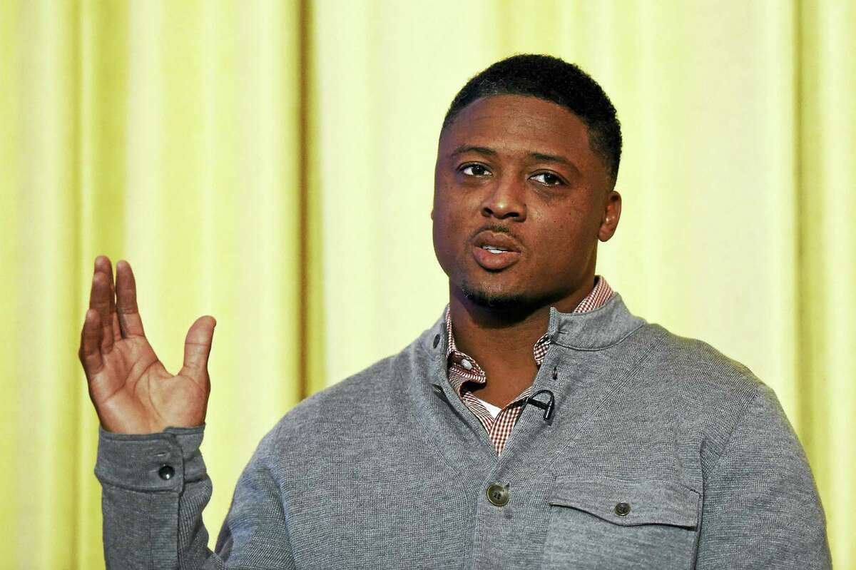 Former Florida State standout Warrick Dunn, seen here in 2014, is this year's Walter Camp Football Foundation Man of the Year.