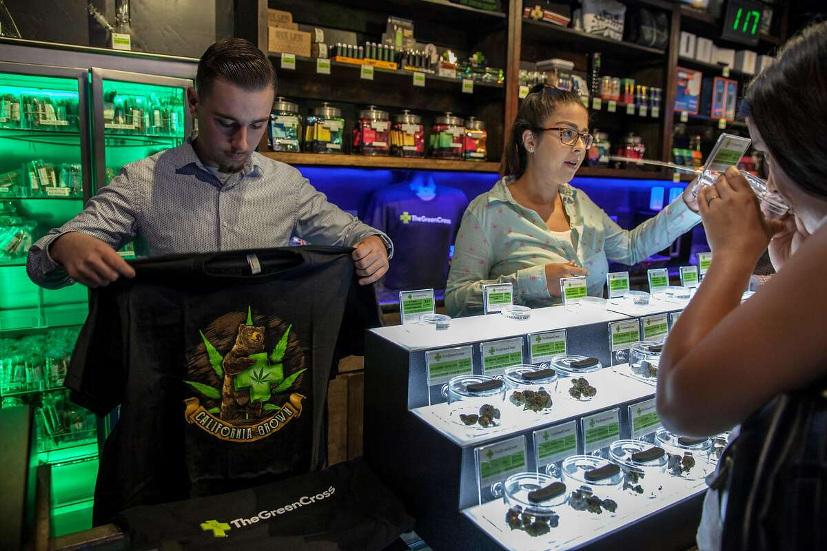 Green Cross cannabis dispensary merchandise, t-shirts that display the Green Cross logo, may too be illegal to sell if a state bill is passed banning pot shops from selling t-shirts and other merchandise with their store name on it -- in order to protect children from cannabis marketing, in San Francisco, California, USA 22 Jul 2017. (Peter DaSilva/Special to The Chronicle)