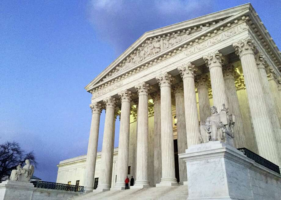 In this Feb. 13, 2016, file photo, people stand on the steps of the Supreme Court at sunset in Washington. The Trump administration made a plea to the Supreme Court on June 1, 2017, to let travel ban take effect Photo: AP Photo/Jon Elswick, File    / Copyright 2016 The Associated Press. All rights reserved. This material may not be published, broadcast, rewritten or redistribu