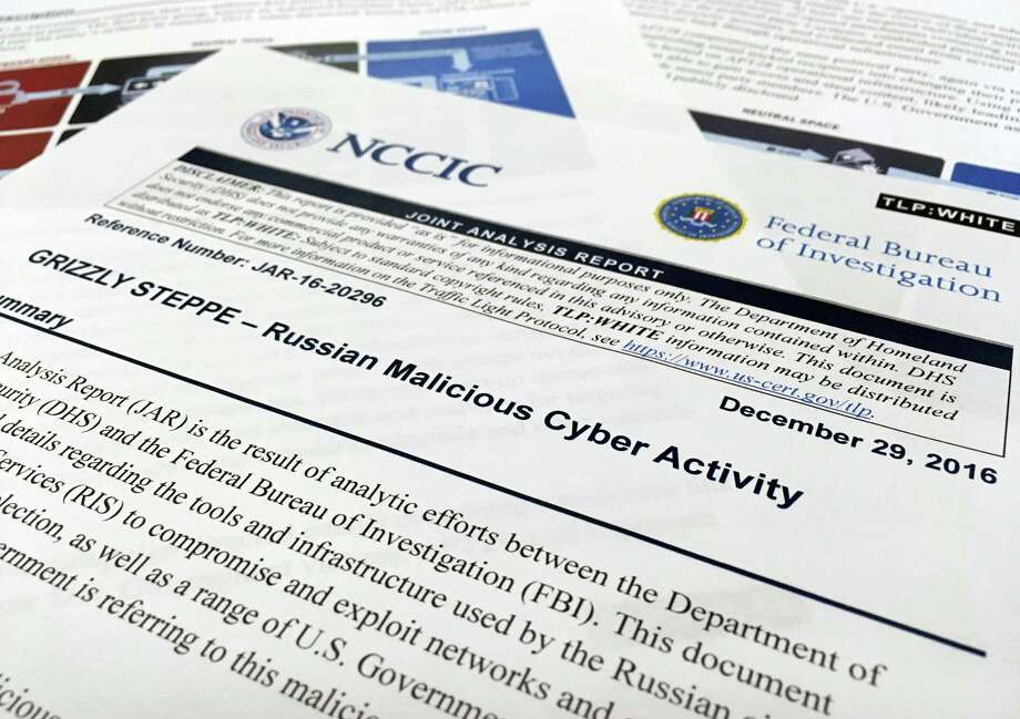 The first page of the Joint Analysis Report narrative by the Department of Homeland Security and federal Bureau of Investigation and released on Dec. 29, 2016 is photographed in Washington on Jan. 6, 2017. Computer security specialists say the technical details in the narrative that the U.S. said would show whether computers had been infiltrated by Russian intelligence services were poorly done and potentially dangerous. Cybersecurity firms ended up counseling their customers to proceed with extreme caution after a slew of false positives led back to sites such as Amazon and Yahoo Inc. Photo: AP Photo/Jon Elswick   / AP