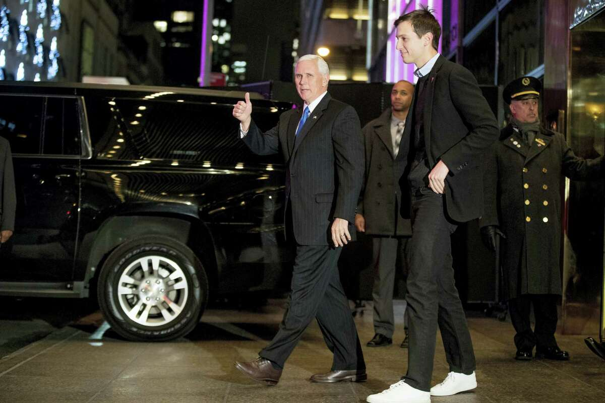 In this Dec. 7, 2016 photo, Vice President-elect Mike Pence, left, and Jared Kushner, second from right, depart from Trump Tower, in New York. Kushner is President-elect Donald Trump's son-in-law and one of his closest advisers.