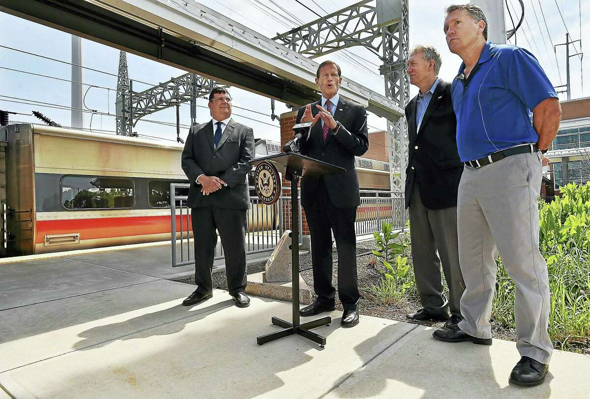 As trains passed through the West Haven Metro-North station, U.S. Sen. Richard Blumenthal held a press conference Thursday, June 2, 2016 along side the Robert E. Luden Memorial, emphasizing the importance of a new regulation by the Federal Railroad Administration (FRA) which will require railroads to use redundant signal protection which will be effective in 2018. Also in attendance, pictured left to right, West Haven Mayor Ed O'Brien, CT Commuter Rail Council Vice Chairman John Hartwell and Robert Luden's first cousin Ray Luden, of Guilford.