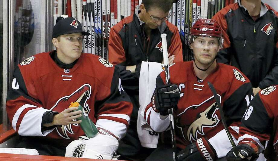 In this file photo, Arizona Coyotes backup goalie Nathan Schoenfeld, left, signed to the team only hours prior to the game, sits next to Shane Doan during the second period of a game. Photo: The Associated Press File Photo   / Copyright 2017 The Associated Press. All rights reserved.