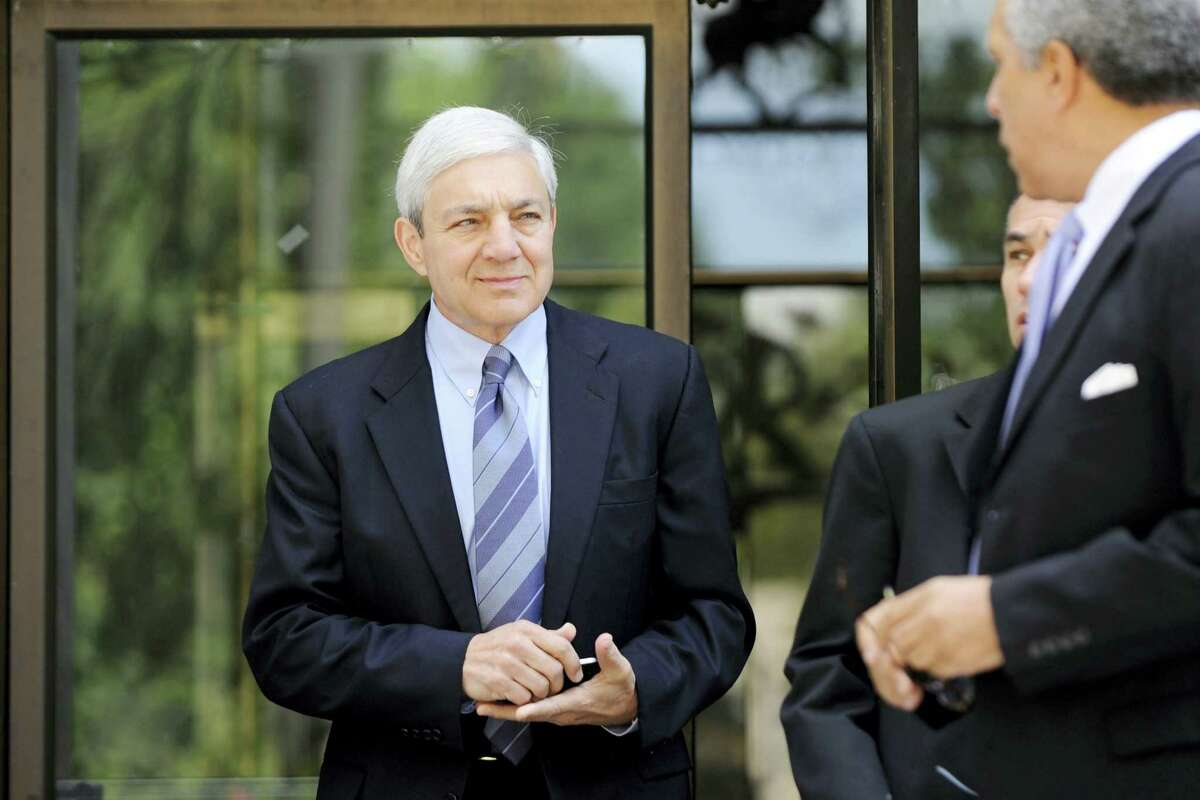 In this July 29, 2013 photo, former Penn State president Graham Spanier exits the Dauphin County Courthouse, in Harrisburg, Pa. Spanier faces charges in the child sex abuse scandal involving former assistant football coach Jerry Sandusky. Spanier, retired university vice president Gary Schultz and ex-athletic director Tim Curley are accused of failing to tell police about a sexual abuse allegation involving Sandusky and then trying to cover it up.