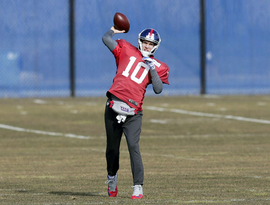 Giants quarterback Eli Manning throws during a recent practice. Photo: Seth Wenig — The Associated Press   / Copyright 2017 The Associated Press. All rights reserved.