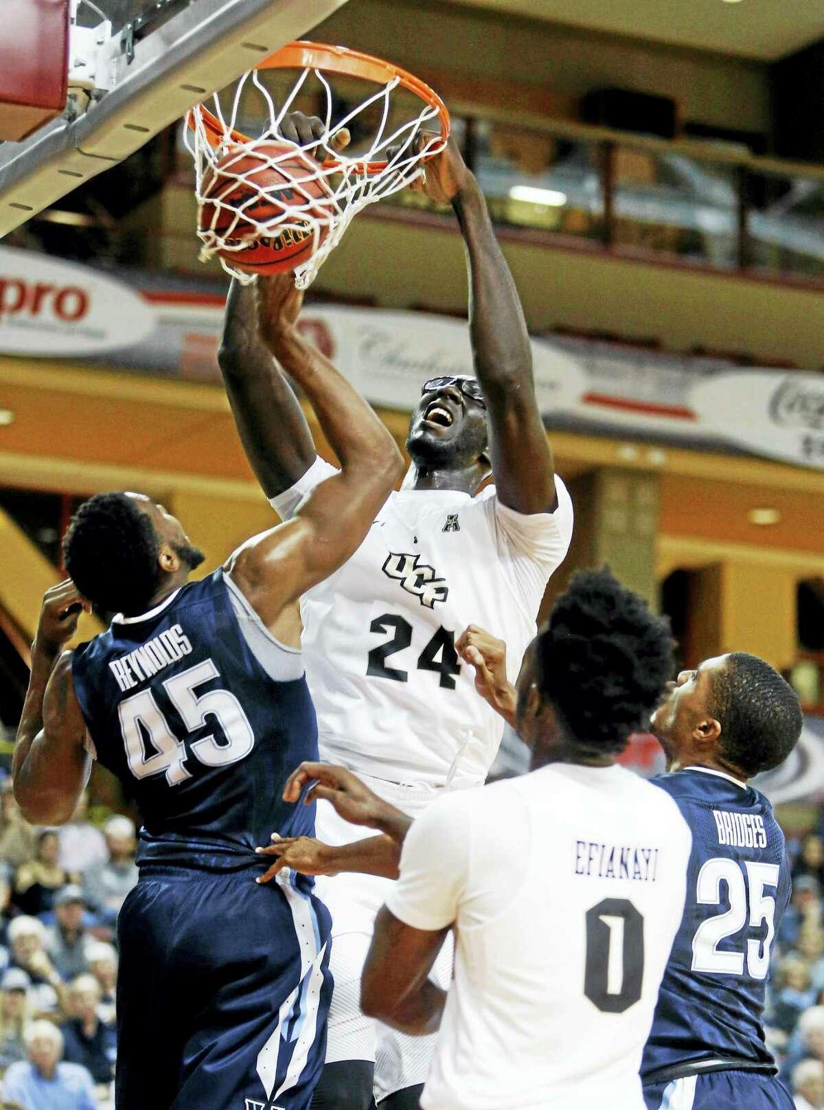 Central Florida's Tacko Fall (24) dunks over the defense of Villanova's Darryl Reynolds.