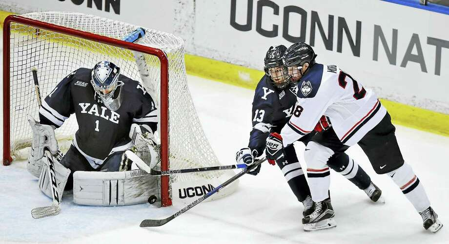 Yale goalie Sam Tucker and forward Evan Smith deny UConn forward Brian Morgan a chance during Saturday's game at the XL Center in Hartford. Photo: Catherine Avalone — Register   / New Haven RegisterThe Middletown Press