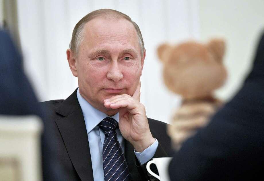 Russian President Vladimir Putin meets with representatives of Russian major animation studios in the Kremlin in Moscow, Russia, Wednesday, May 31, 2017. Photo: Alexei Nikolsky/Sputnik, Kremlin Pool Photo Via AP    / POOL SPUTNIK KREMLIN