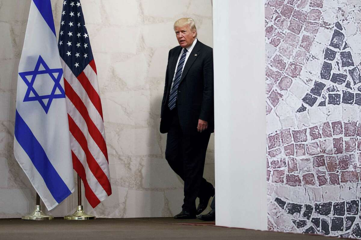 In this May 23, 2017, file photo, President Donald Trump arrives to speak at the Israel Museum in Jerusalem. A senior Israeli official is expressing disappointment over Trump's decision against relocating the embassy to Jerusalem and is accusing the U.S. of caving in to Arab pressure.