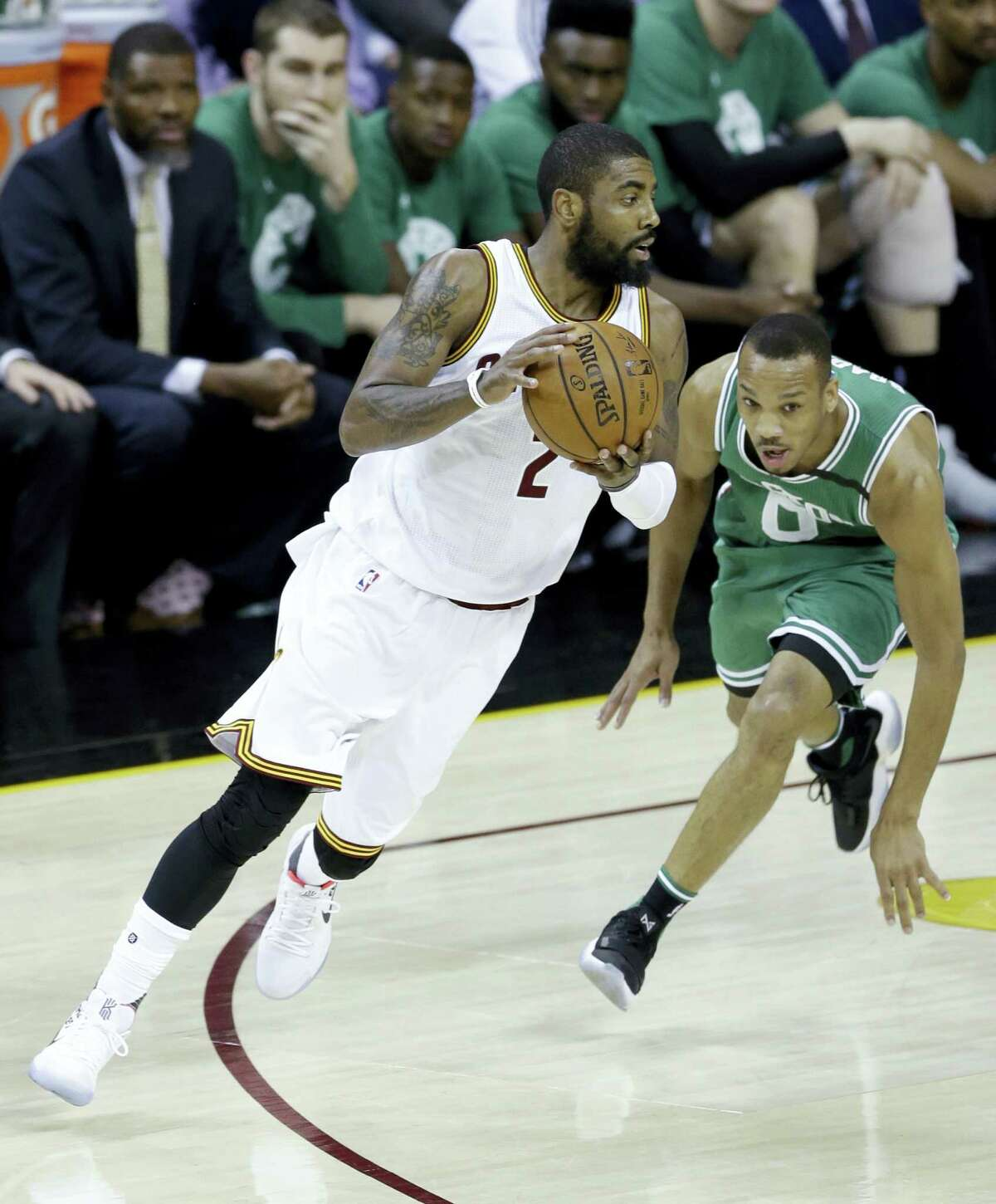 Cleveland Cavaliers' Kyrie Irving (2) drives against Boston Celtics' Avery Bradley (0) during the first half of Game 4 of the NBA basketball Eastern Conference finals on May 23, 2017 in Cleveland.