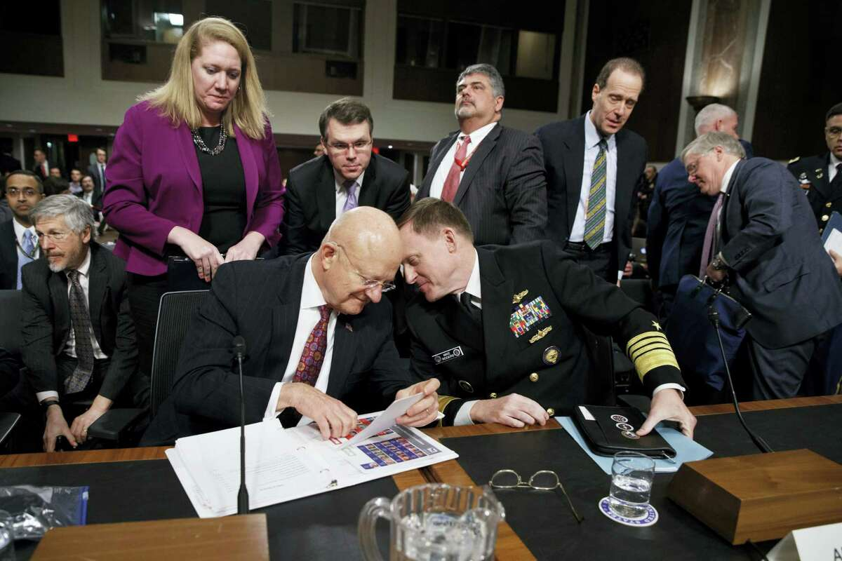 """Director of National Intelligence James Clapper, left, talks with National Security Agency and Cyber Command chief Adm. Michael Rogers on Capitol Hill in Washington, Thursday, Jan. 5, 2017, at the conclusion of a Senate Armed Services Committee hearing: """"Foreign Cyber Threats to the United States."""""""