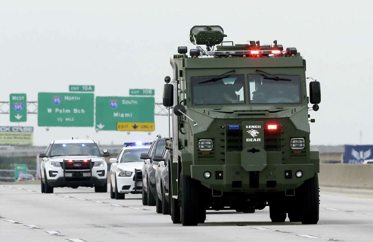 Law enforcement officials head to Fort Lauderdale-Hollywood International Airport, Friday, Jan. 6, 2017, in Fort Lauderdale, Fla. A gunman opened fire in the baggage claim area at the airport Friday, killing at least five people and wounding others before being taken into custody.