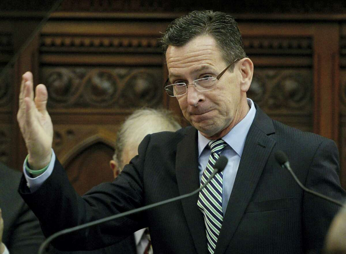 Connecticut Gov. Dannel P. Malloy gestures after delivering the State of the State address during opening session at the state Capitol, Wednesday in Hartford