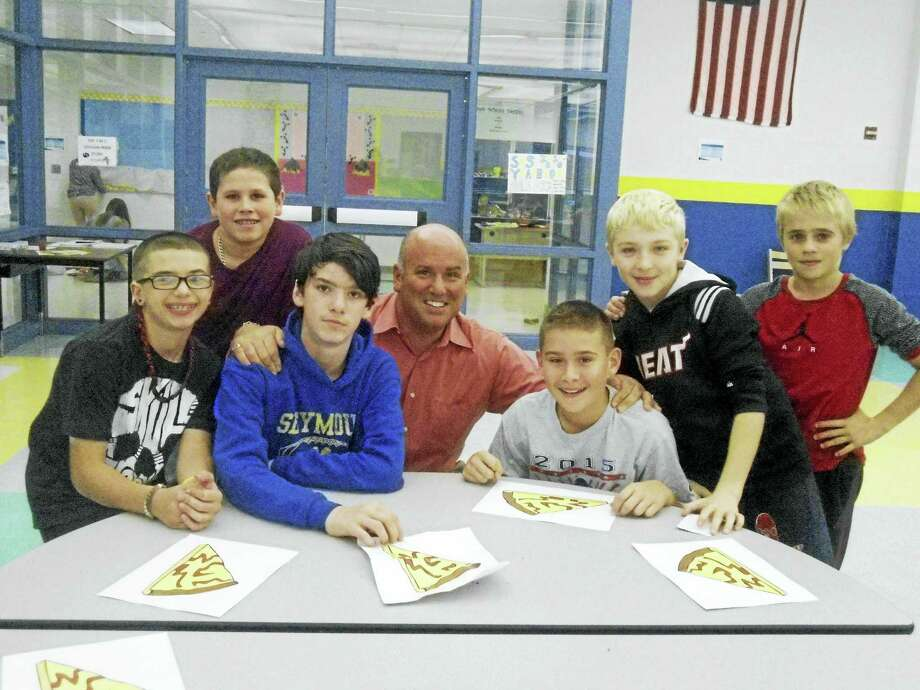 From left, Henry Dzwonkowski, Izaiha Nunez, Adam Violano, Ernie DiStasi, Anthony Dadio, Phaelan White and Sean Foster. Photo: Seymour Middle School Yearbook   / Copyright 2009