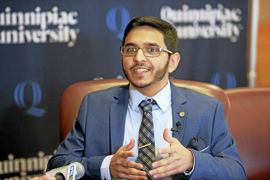 Quinnipiac University junior Ali Munshi of Trumbull talks about his upcoming trip to Washington, D.C., to attend the presidential inauguration. Photo: Contributed Photo — Quinnipiac University   / (Autumn Driscoll / Quinnipiac University)