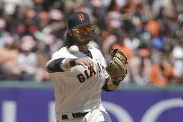 San Francisco Giants shortstop Brandon Crawford, top, throws to first base for a double play after forcing out San Diego Padres' Manuel Margot, bottom, at second base during the fifth inning of a baseball game in San Francisco, Sunday, July 23, 2017. (AP Photo/Jeff Chiu)