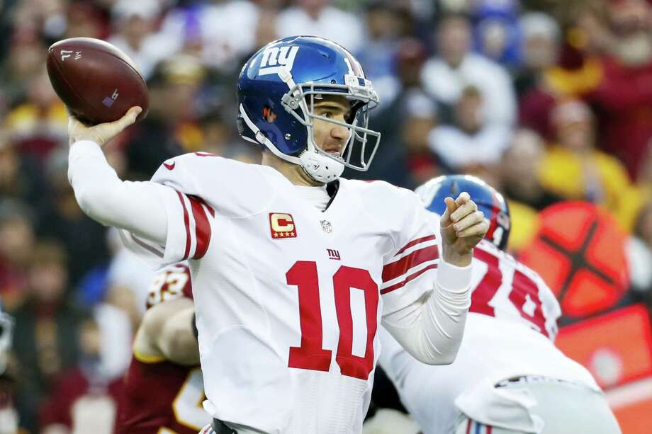 New York Giants quarterback Eli Manning (10) throws a pass during the first half of the team's NFL football game against the Washington Redskins in Landover, Md. on Jan. 1, 2017. Photo: AP Photo/Alex Brandon   / Copyright 2017 The Associated Press. All rights reserved.