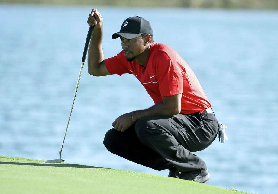 Tiger Woods filled out the rest of his early schedule Thursday by saying he would return to the Omega Dubai Desert Classic. Photo: Lynne Sladky — The Associated Press File   / Copyright 2016 The Associated Press. All rights reserved.