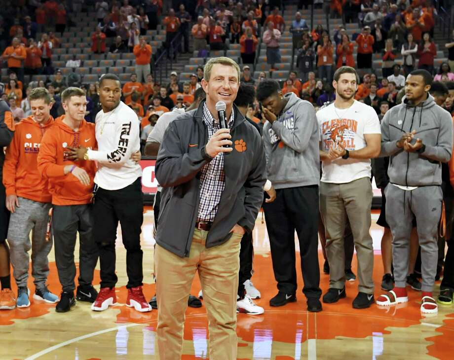 Clemson football coach Dabo Swinney speaks to the fans during halftime of a basketball game against North Carolina. Photo: Richard Shiro — The Associated Press   / FR159523 AP