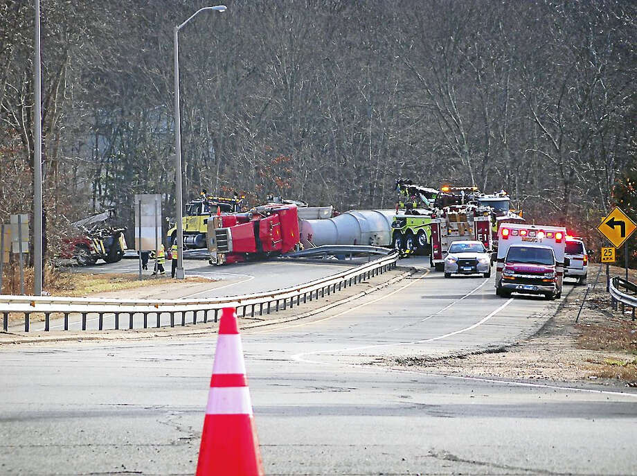 The northbound Exit 55 on-ramp and off-ramp from Interstate 95 in Branford were shut down for hours Thursday after a tanker truck rolled over and crashed. No one was hurt in the accident. Photo: Wes Duplantier — New Haven Register