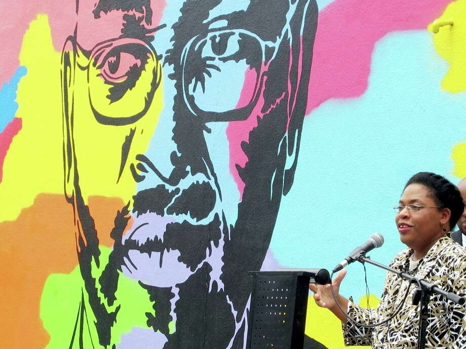 In this May 13, 2016, file photo, Jennifer Pinckney speaks beside an image of her late husband, the Rev. Clementa Pinckney, one of the victims of the shooting at Charleston's Emanuel AME Church, during the unveiling of the mural on a building a few blocks from the sanctuary. Convicted Charleston church shooter Dylann Roof spoke to the jury for the first time at his death penalty trial Wednesday, telling them there's nothing wrong with him psychologically and that he is not trying to keep any secrets from them. As their first witness, prosecutors called Pinckney. During more than two hours on the stand, Pinckney described her husband as an affable figure who garnered respect from all corners in his roles as legislator and preacher but was a goofy family man in private with his two young daughters. Photo: AP Photo/Bruce Smith, File    / Copyright 2017 The Associated Press. All rights reserved.