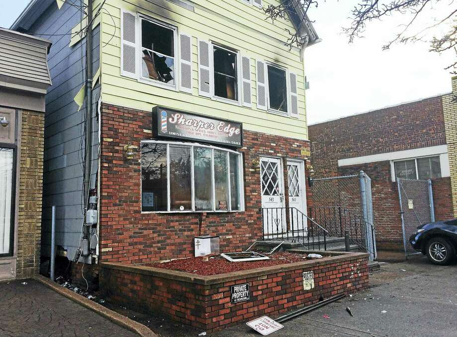 The American Red Cross is helping an adult and three children after a fire late Tuesday damaged a building at 541-543 Whalley Ave. in New Haven. Photo: Wes Duplantier — New Haven Register
