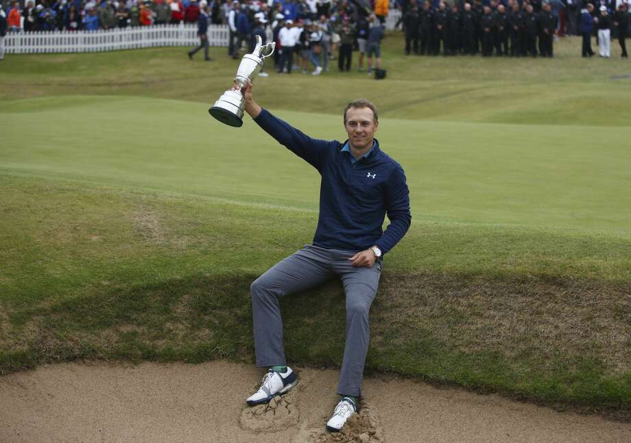 Jordan Spieth of the United States holds the trophy after winning the British Open Golf Championships at Royal Birkdale, Southport, England, Sunday July 23, 2017. (AP Photo/Dave Thompson) Photo: Dave Thompson/Associated Press