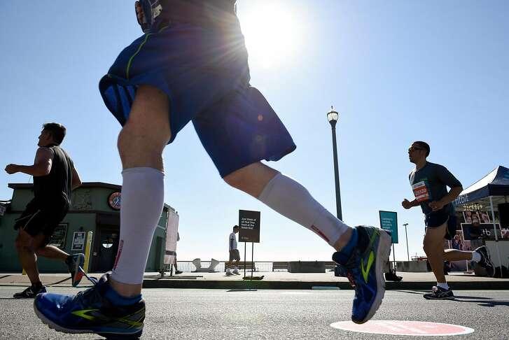 Participants of the 2017 San Francisco Marathon run along the Embarcadero in San Francisco, CA, on Sunday July 23, 2017.
