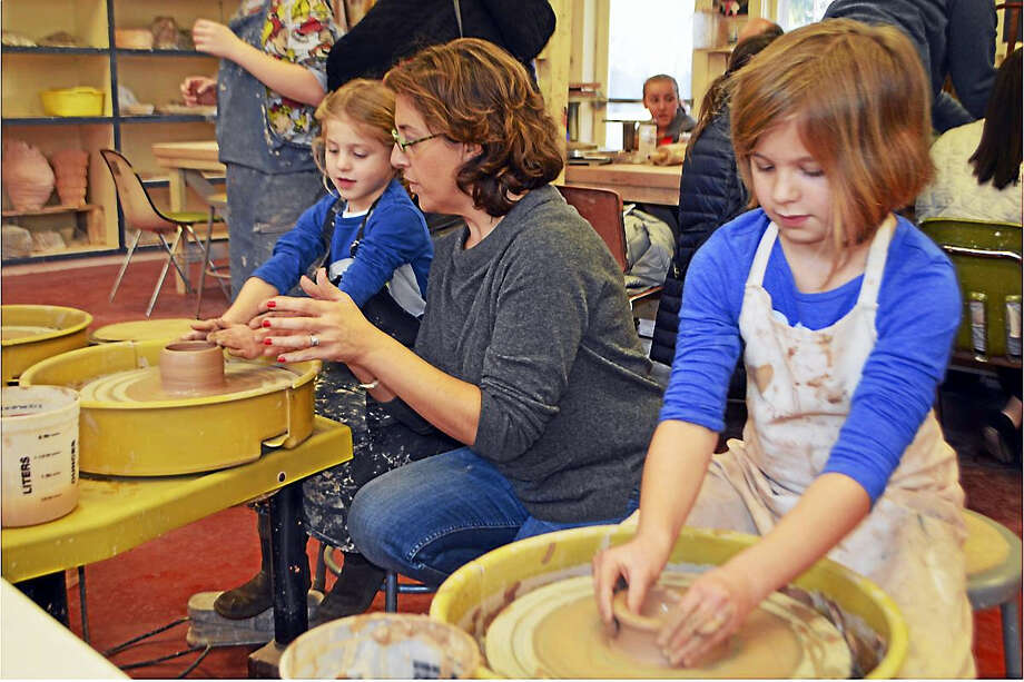 Children get instruction in pottery at a previous Open Arts Day. Photo: Photo Courtesy Of GAC