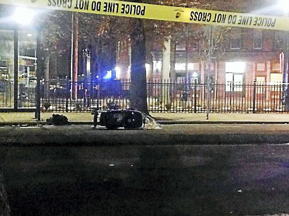 Police tape blocks off an area of Goffe Street in New Haven while police investigate after a toddler was struck by a car on Wednesday. Photo: Juliemar Ortiz — New Haven Register
