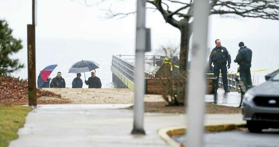 West Haven Police investigate the scene where a body was found at Altschuler Beach in West Haven. Photo: Arnold Gold — New Haven Register