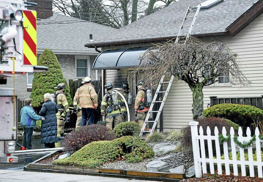 The Milford Fire Department responds to a fire at 24 Ward St. in Milford on Tuesday. Photo: Arnold Gold — New Haven Register