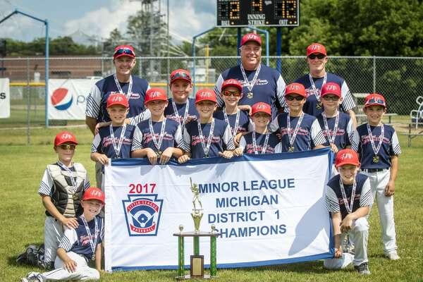DANIELLE McGREW TENBUSCH   for the Daily News The Midland Fraternal Northwest beat Gladwin 12-2 to claim the Minor League District 1 championship at Mount Pleasant on Sunday.