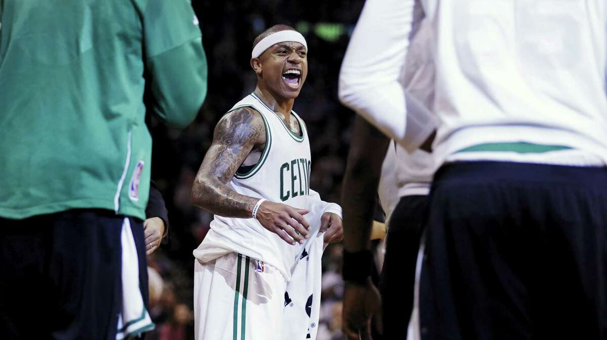 Boston Celtics guard Isaiah Thomas celebrates as he heads to the bench for a timeout against the Utah Jazz during the second half Tuesday. Thomas scored 29 points.