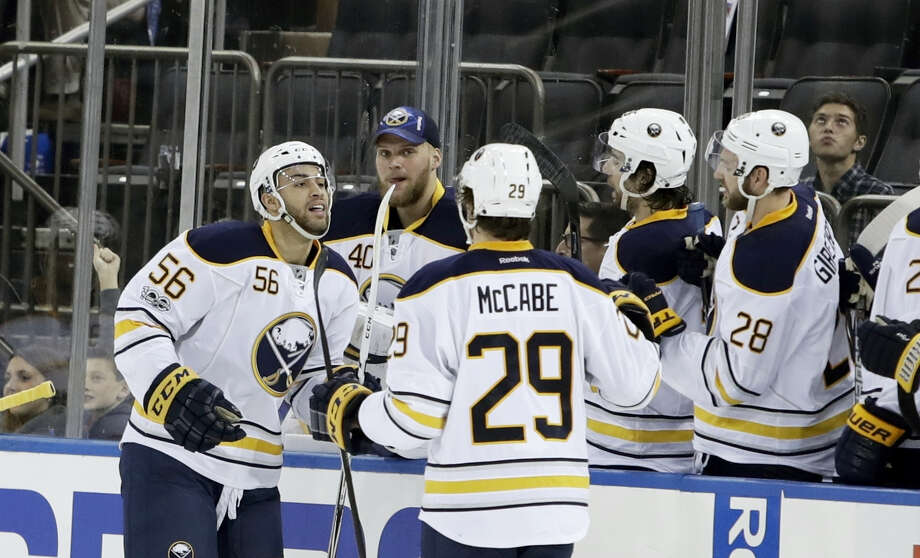 Buffalo Sabres' Justin Bailey (56) celebrates with teammates after scoring a goal during the second period of an NHL hockey game against the New York Rangers Tuesday. Photo: FRANK FRANKLIN II — THE ASSOCIATED PRESS   / Copyright 2017 The Associated Press. All rights reserved.