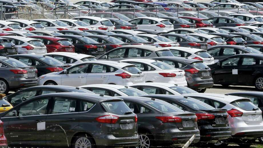 Ford Focus vehicles are seen on a storage lot in Ypsilanti, Mich. Photo: AP Photo/Carlos Osorio/File   / AP