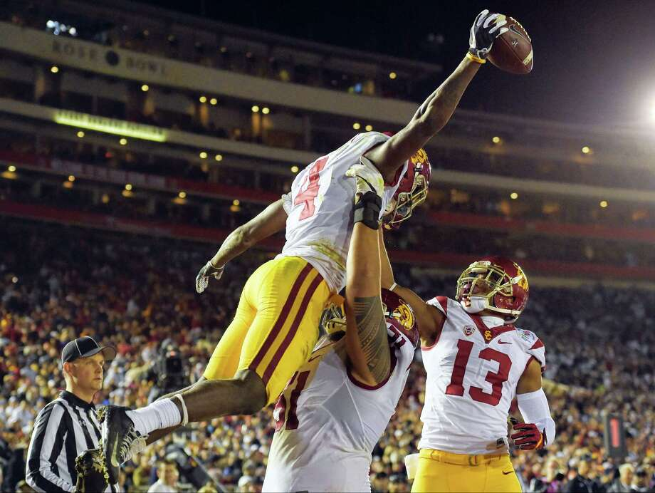 Southern California running back Ronald Jones II, left, celebrates with De'Quan Hampton, right, and Damien Mama after scoring during the second half of the Rose Bowl against Penn State Monday. Photo: Mark J. Terrill — The Associated Press    / Copyright 2017 The Associated Press. All rights reserved.