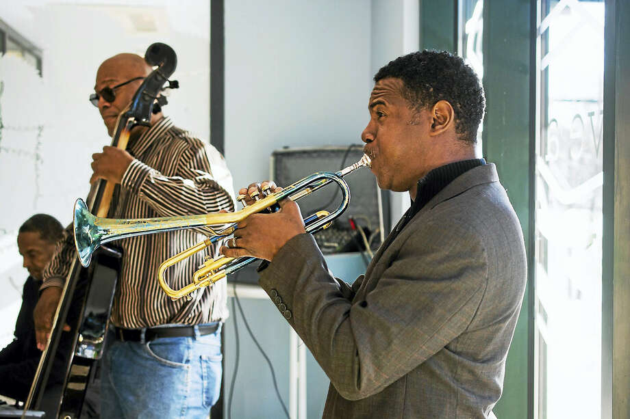Morris Trent, center, and his band perform at a recent Sunday Jazz Brunch at Elm City Market. Photo: Photo Courtesy Of Luis Cuevas/Elm City Market