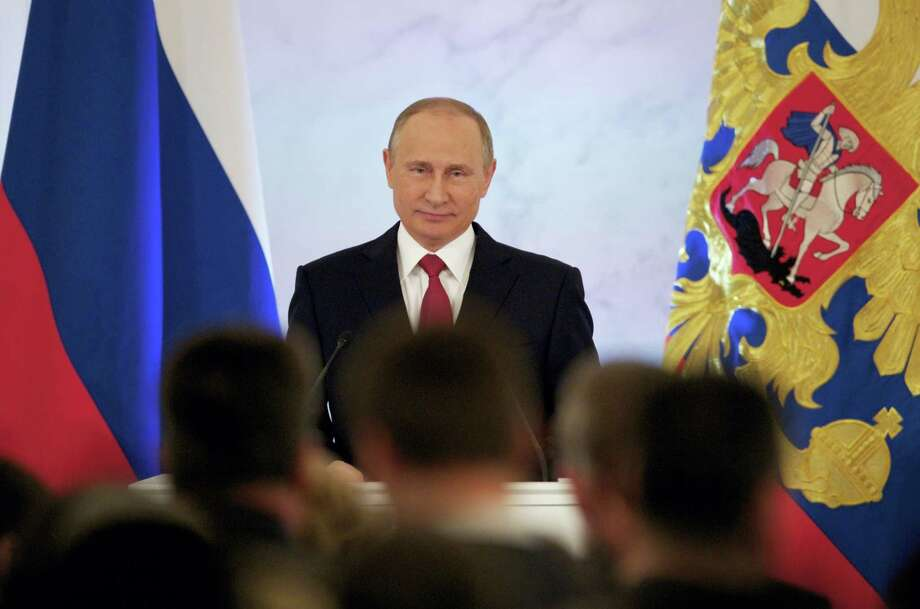 Russian President Vladimir Putin smiles as he gives his annual state of the nation address in the Kremlin in Moscow, Russia, Dec. 1. Photo: AP Photo/Pavel Golovkin / Copyright 2016 The Associated Press. All rights reserved.